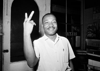 Dr. Martin Luther King, Jr. reacts in St. Augustine, Fla., after learning that the senate passsed the civil rights bill, June 19, 1964.  (AP Photo)