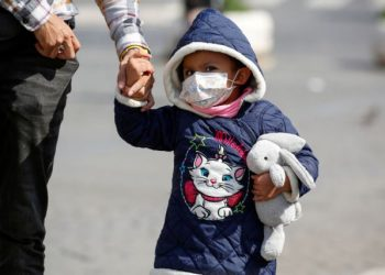 A child wearing a protective face mask walks near the Colosseum, after a decree orders for the whole of Italy to be on lockdown in an unprecedented clampdown aimed at beating the coronavirus, in Rome, Italy, March 10, 2020. REUTERS/Remo Casilli REFILE - CORRECTING GENDER.